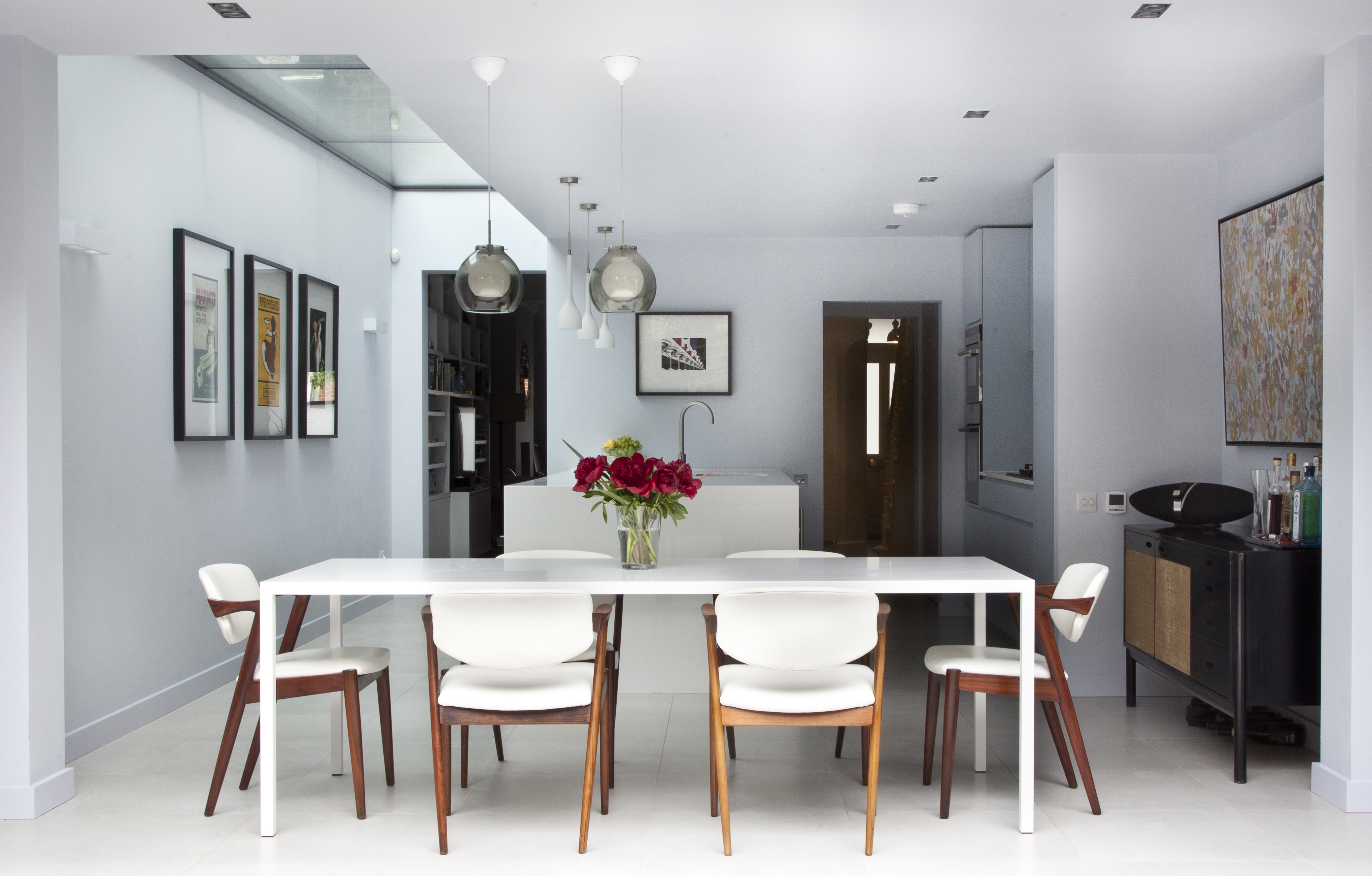 Bright dining area with white table and chairs