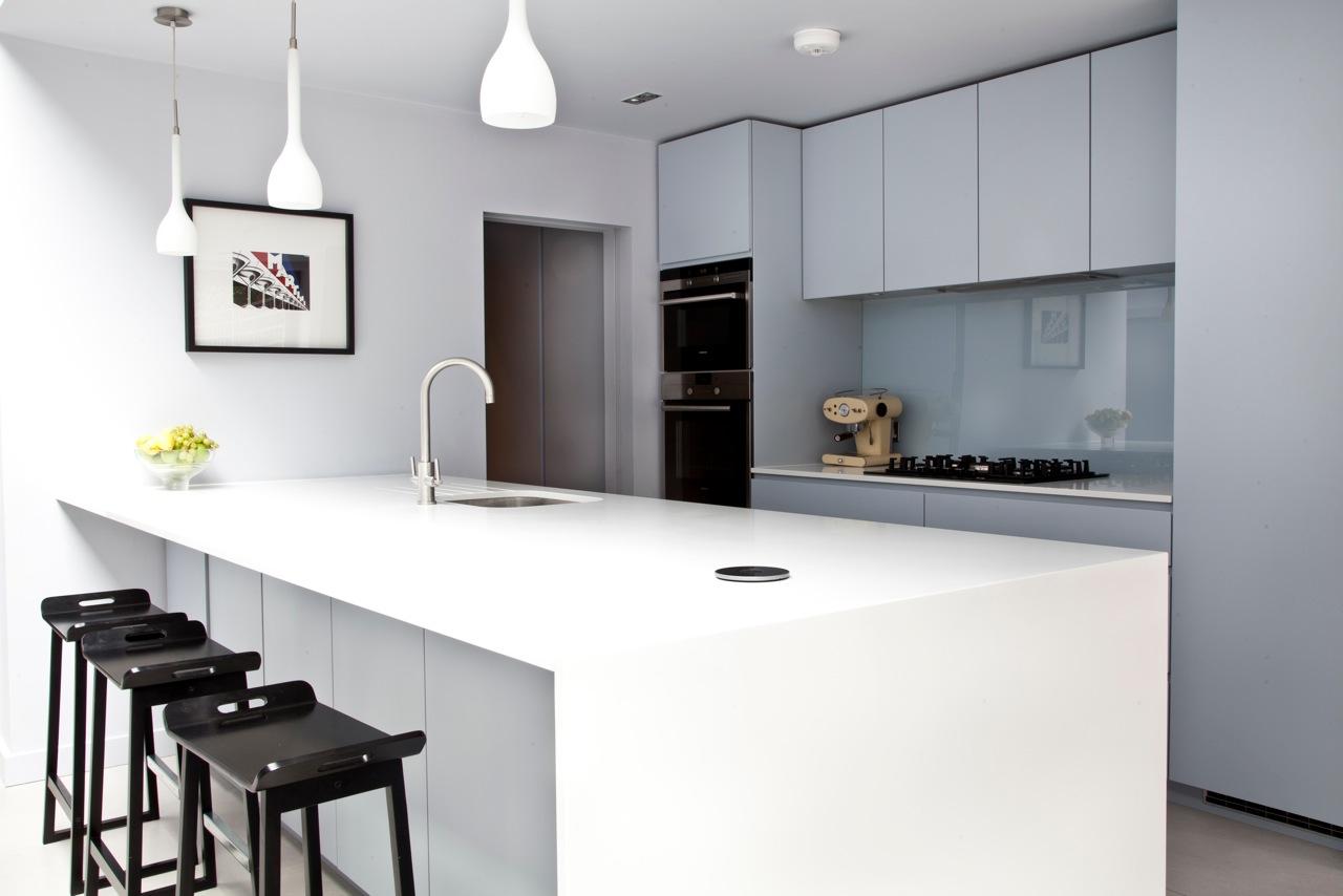 Minimal white kitchen island in clutter-free kitchen