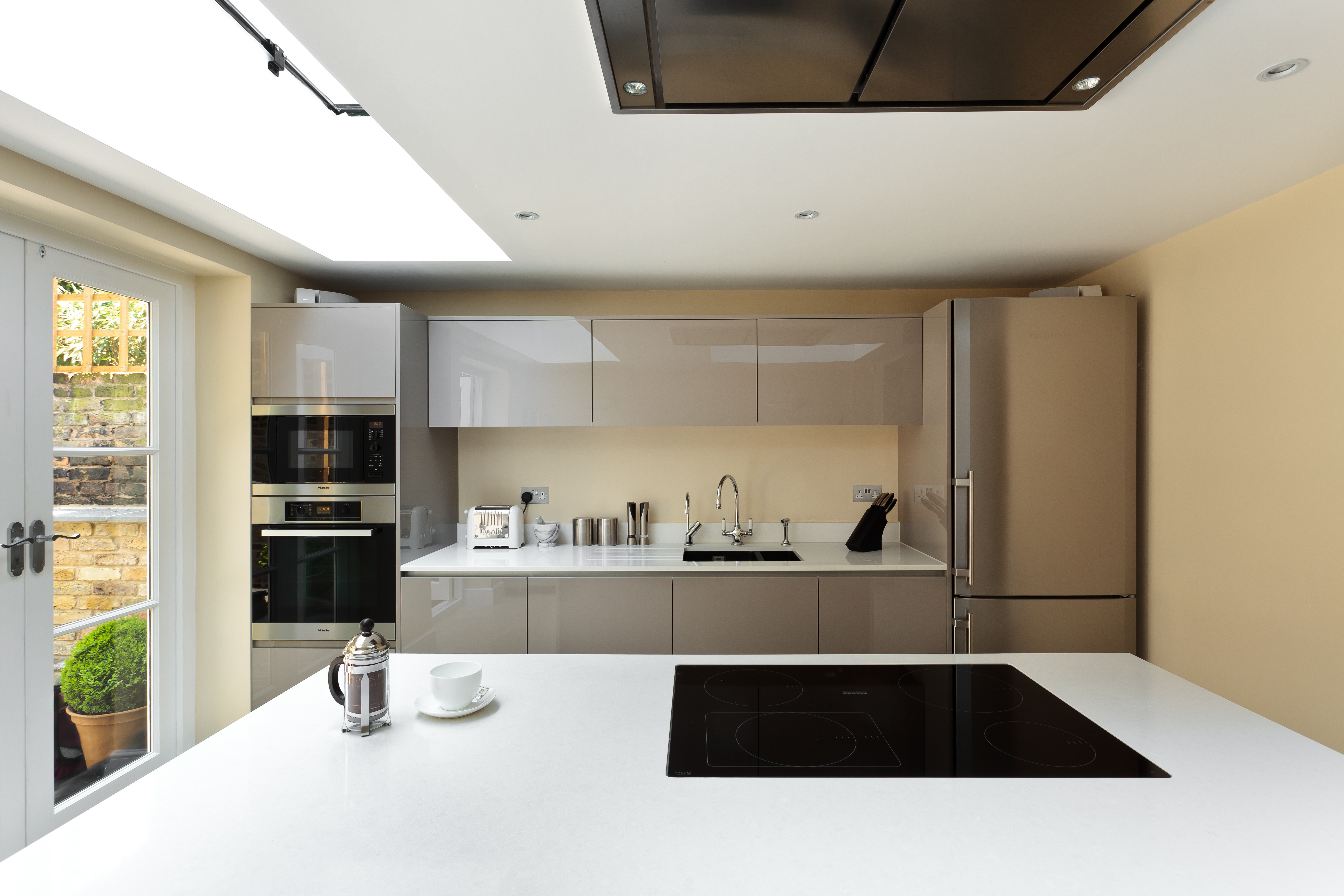 Clutter free family kitchen with large island
